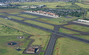Lihue Airport - Runway 3-21 and the passenger terminal in background; fire station in foreground.