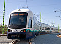 Link Light Rail train at Operations & Maintenenace Facility (8754013919).jpg