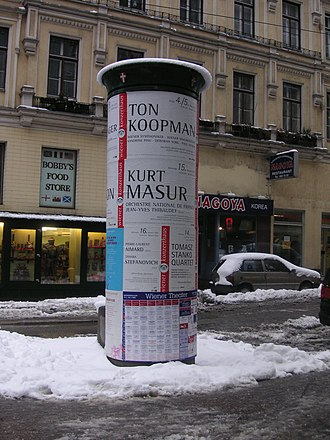 Ernst Litfaß - A Litfaßsäule in Vienna, Austria. The advertisements are for concerts with Ton Koopman and Kurt Masur respectively; at the bottom there is the weekly programme of the theatres of Vienna.