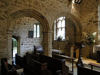Old Church of St Nidan, Llanidan - The interior, looking from the south-west corner, showing two of the arches separating the aisles