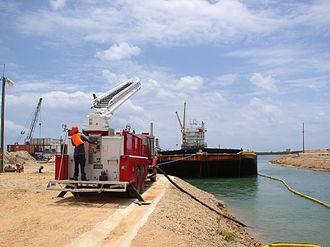 Big Creek, Belize - Oil barge being loaded at Big Creek Port