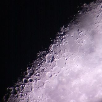 Lunar craters - Lunar craters as captured through the backyard telescope of an amateur astronomer, partially illuminated by the sun on a waning crescent moon.