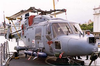 HMS Cardiff (D108) - Cardiffs Lynx helicopter, no. 335, with a Sea Skua missile