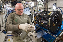 NASA astronaut Scott Kelly, Expedition 26 commander, works on the Combustion Integrated Rack (CIR) Multi-user Drop Combustion Apparatus (MDCA) in the Destiny laboratory of the International Space Station.