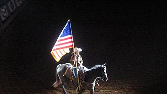 Cowtown Coliseum - The rider with the American flag opens the Fort Worth Championship Rodeo.