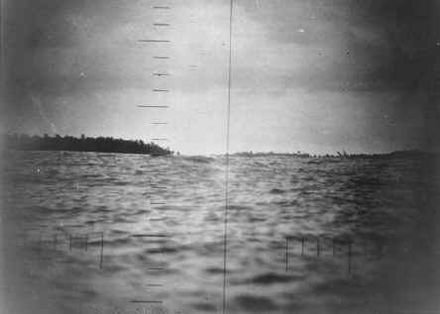 Photograph of Makin Island taken from USS Nautilus during the raid on the island in August 1942. MakinRaidPeriscope.jpg