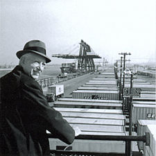 Malcolm McLean at railing, Port Newark, 1957 (7312751706).jpg