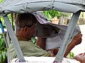 Man in Tuk-Tuk with Newspaper - Hua Hin - Thailand (34863096695).jpg