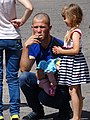 Man with Children - Opishnya - Ukraine (42122503720).jpg