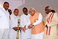 Manohar Lal Khattar along with the Minister of State for Labour and Employment (Independent Charge), Shri Bandaru Dattatreya lighting the lamp to inaugurate the 'MODI FEST' (Making of Developed India Festival), in Hyderabad.jpg