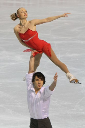 Pair skating - A hand-to-hand-lift. Overhead rotational with release to one-hand hold