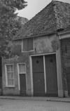 foto van Huis onder schilddak met gepleisterde voorgevel en zijgevel (inmiddels gesloopt)