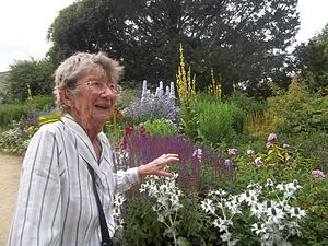 Mary Spiller - Photo of Mary in front of the herbaceous border at Waterperry Gardens in 2013.