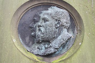 John Rhind (sculptor) - Medallion head of John Rhind and his wife on his grave in Warriston Cemetery Edinburgh