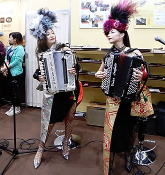 Piano accordionist and chromatic button accordionist at Tokyo Big Sight MeguRee the duo of Dino Baffetti Chromatic Button Accordion Excelsior Piano Accordion.jpg