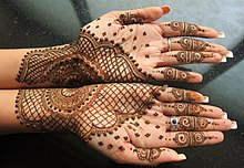 Mehndi henna applied on both hands front view