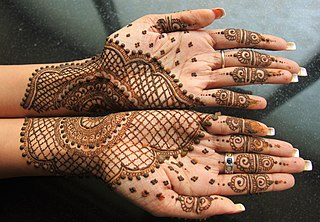 Mehndi form of body art from Ancient India, in which decorative designs are applied on a persons body using a paste of the powdered dry leaves of the henna plant (Lawsonia inermis)