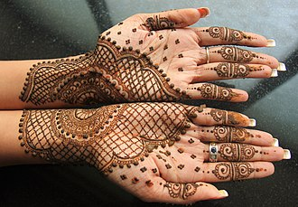 Henna - Mehndi, a form of body art from Ancient India, applied on both hands.