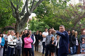 Auction - An estate agent, John Morrisby, conducting an auction of real estate in Melbourne, Victoria, Australia.
