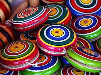 Yo-yo - After the yo-yo was introduced to the United States, it spread to Mexico—a pile of handmade wood Mexican yo-yos is pictured
