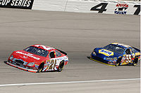 Ken Schrader #21 and Michael Waltrip #55 in th...