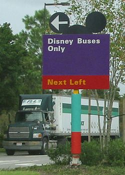 A typical style of sign in Walt Disney World, showing one of many uses by Disney of the Mickey ears logo.