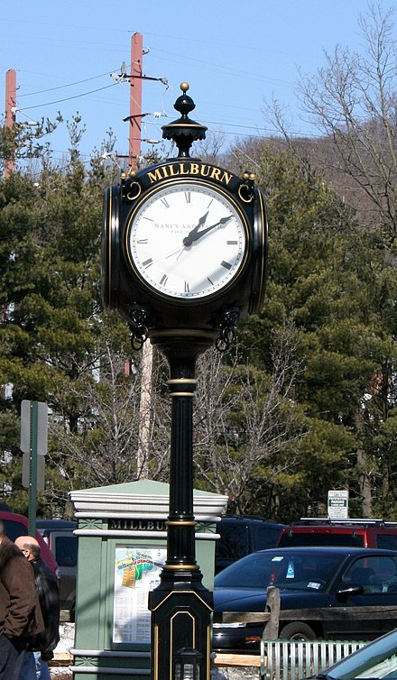 Clock tower at the intersection of Main and Essex Streets Milburn NJ clock.JPG