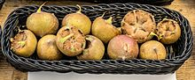 basket full of small, brown, round fruits