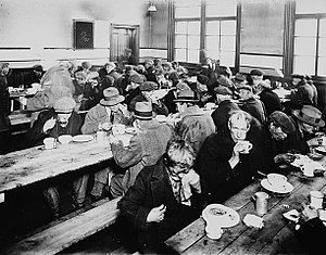 People eating at a soup kitchen. Montreal, Canada