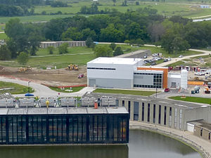 Fermilab - Muon g−2 building (white and orange) which hosts the magnet