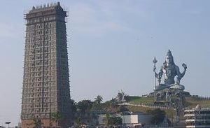 Gopura of Murdeshwar Temple and statue of Shiva