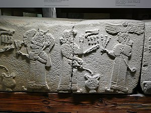 Tiwaz (Luwian deity) - Libation offering to the Sun-god Tiwaz (right, with winged sun) and the Moon-god Arma (left, with crescent moon) in a relief from Arslantepe.