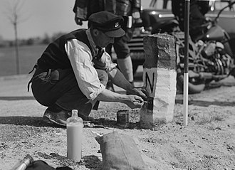 Dutch annexation of German territory after World War II - A boundary marker being painted in Elten, 1949. The village was returned to German hands in 1963.