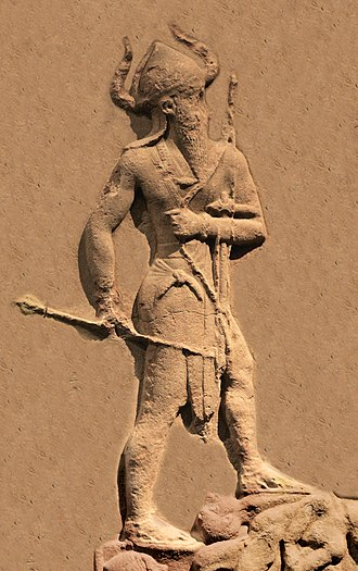 Naram-Sin of Akkad - Naram-Sin, from his victory stele, standing on a pile of Lullubian corpses.
