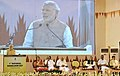 Narendra Modi addressing at the launch of the India Handloom brand, on the occasion of the National Handloom Day, in Chennai, Tamil Nadu. The Governor of Tamil Nadu, Dr. K. Rosaiah.jpg