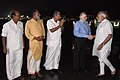 Narendra Modi being received by the Governor of Kerala, Justice (Retd.) P. Sathasivam, the Chief Minister of Kerala, Shri Pinarayi Vijayan and the Minister of State for Tourism (IC), Shri Alphons Kannanthanam, on his arrival.JPG