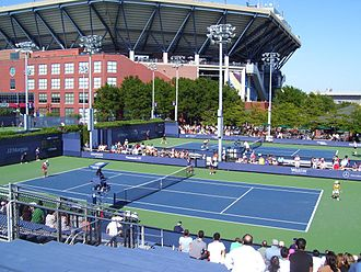 USTA Billie Jean King National Tennis Center - Some of the side courts, with Ashe Stadium in the background
