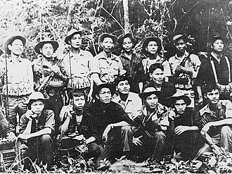 Tet Offensive - Viet Cong troops pose with new AK-47 assault rifles and American field radios