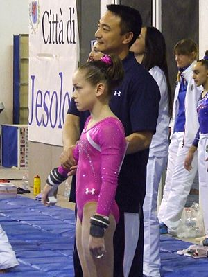 Liang Chow - Liang Chow with athlete Norah Flatley at the 2014 City of Jesolo Trophy.