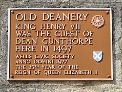 Old deanery wells brown plaque
