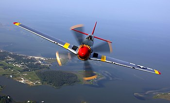 P-51 Mustang in flight during an air show at L...