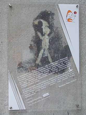 Orange Alternative - The last remaining Orange Alternative Dwarf on Madalińskiego Street in Warsaw. Originally painted on the paint spot covering up the logo of another anti-communist group Solidarność Walcząca