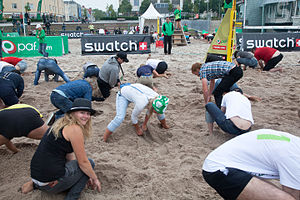 Treasure hunt (game) - Players searching for hidden treasure, buried in sand