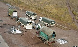 Pakistani relief personnel wating for supplies, 2005.jpeg