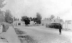 Papanui - Papanui Junction looking from Papanui Road towards the Papanui Hotel sited on the Main North Road and Jacksons Seven Oaks Butchery (with two chimneys) in the late 1870s