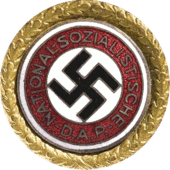 a circular golden badge with a central swastika