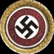 a circular golden badge with a central swastika