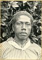 Photograph (black and white); portrait of a man, in front of a bush, wearing a striped shirt and a piece of cloth tied around his neck; Tonga. Platinum print. Oc,B54.23, British Museum.jpg