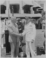 Photograph of President Truman shaking hands with Admiral Marc Mitscher, commander of the 8th Fleet and wartime... - NARA - 199397.tif