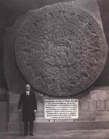 Porfirio Diaz in 1910 at the National Museum of Anthropology with the Aztec Calendar Stone. It was previously on display in the open air, up against the cathedral wall. Piedra del sol Porfirio Diaz.png